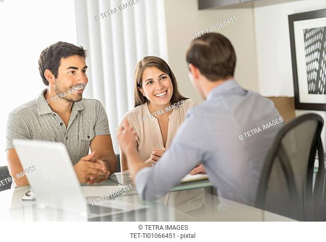 Customers talking to advisor in office