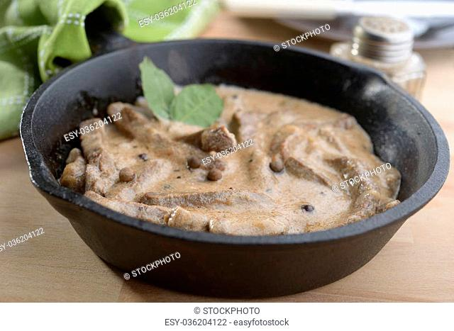 Beef Stroganoff in a cast-iron pan