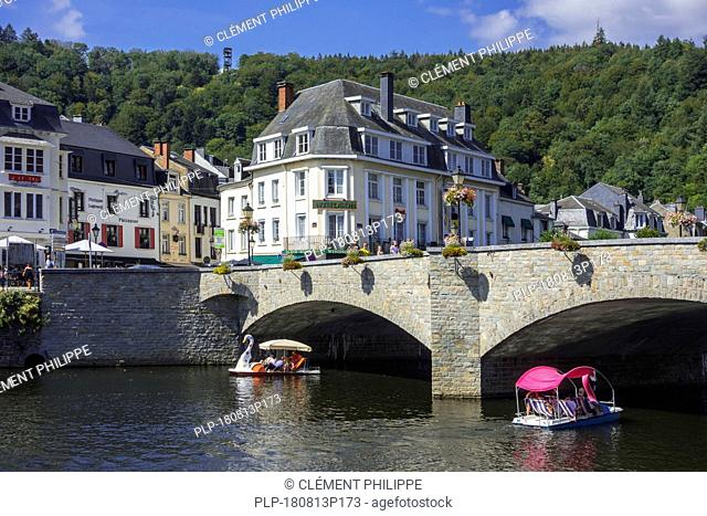 Paddle boats with tourists passing under the bridge Pont de Liège in the city Bouillon in summer, Luxembourg Province, Belgian Ardennes, Belgium