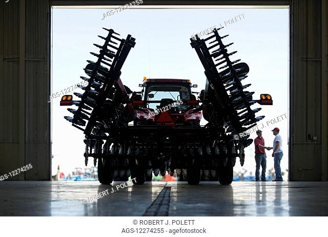New 4 wheel drive tractor with folding disk ready for delivery from dealership; Nevada, Iowa, United States of America