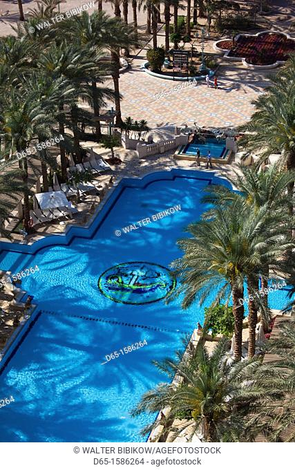 Israel, The Negev, Eilat, Red Sea beachfront, elevated view of Herods Palace Hotel swimming pool