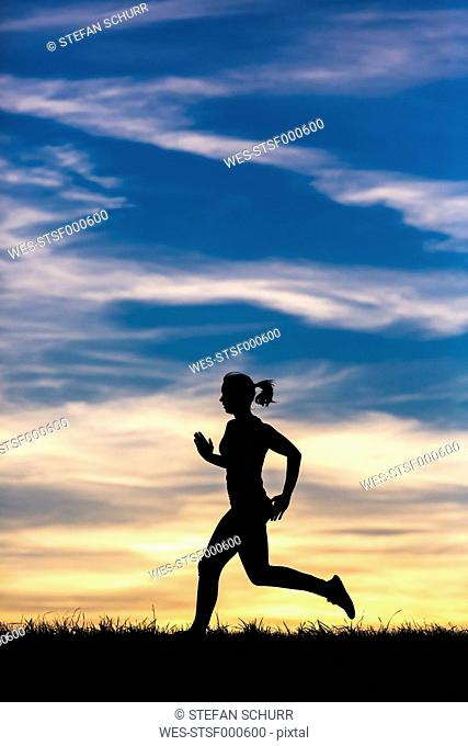 Silhouette of jogger at sunset