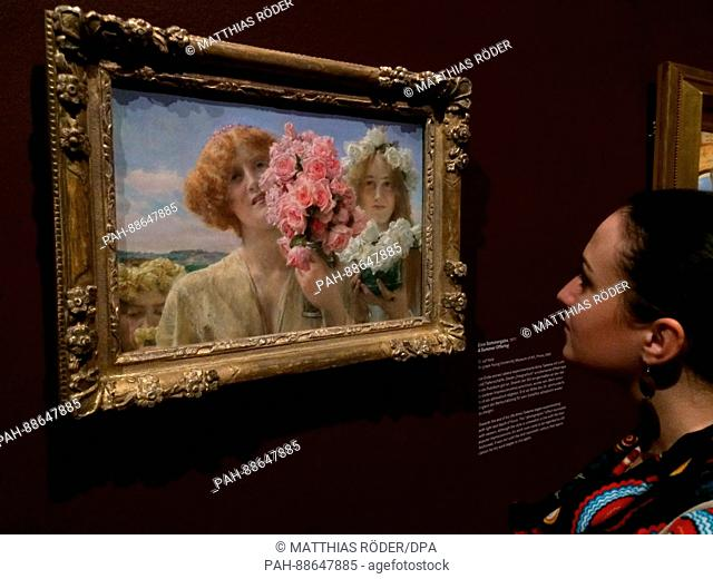 A visitor stands in front of the painting 'Eine Sommergabe' (1911) by Lawrence Alma-Tadema at the exhibition 'Lawrence Alma-Tadema Dekadenz & Antike' at the...