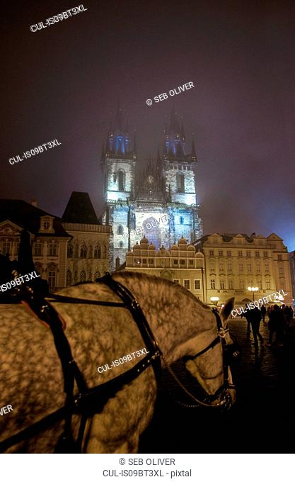 Horse-drawn carriage in foreground, Church of Our Lady before Týn, Old Town Square, Prague, Czech Republic
