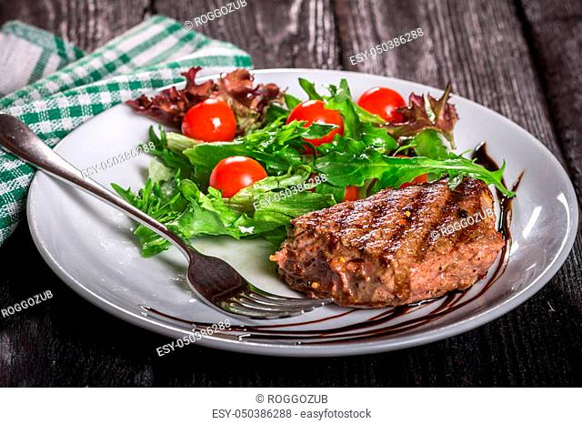 steak and salad on a plate