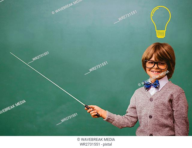 kid and blackboard with lightbulb against a black background