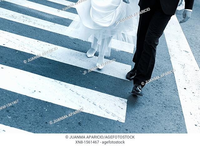 Newly married couple a pedestrian crossing