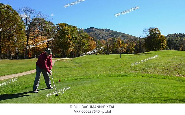 Jackson New Hampshire golfer in Wentworth Country Club in Northern New England in fall foliage in October 7