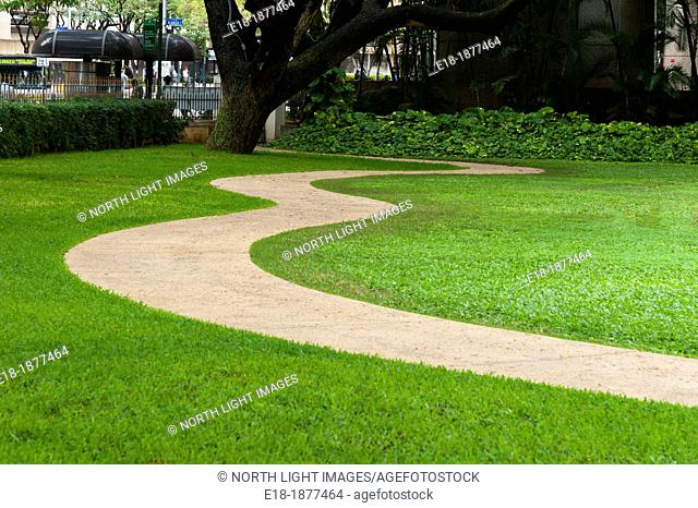 USA, Hawaii, Oahu, Honolulu  Concrete sidewalk curving through the lawn in public park
