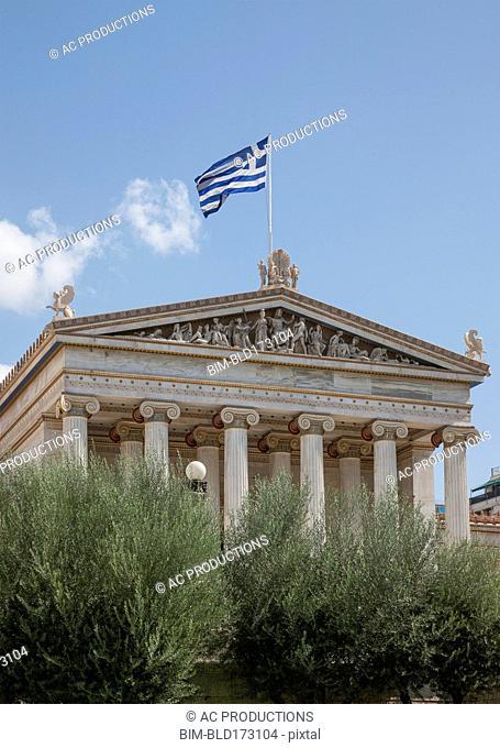 Academy building under blue sky, Athens, Greece