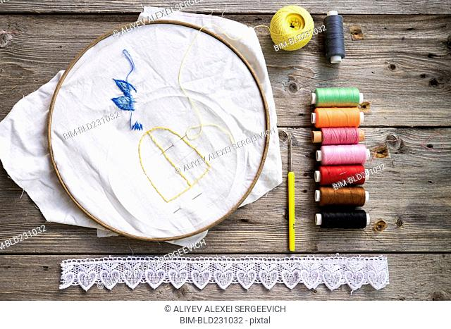 Multicolor thread and lace with needlepoint hoop