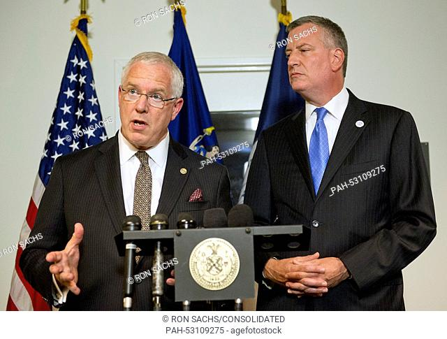 Mayor Bill de Blasio of New York City, right, looks on as NYPD Deputy Commissioner of Intelligence & Counter-terrorism John Miller answers a question during a...
