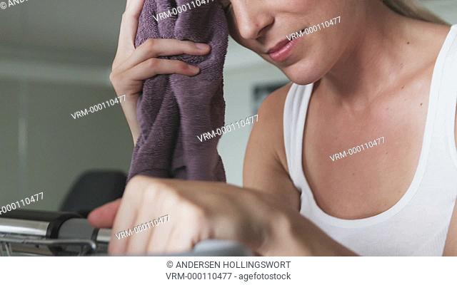 woman toweling off after working out
