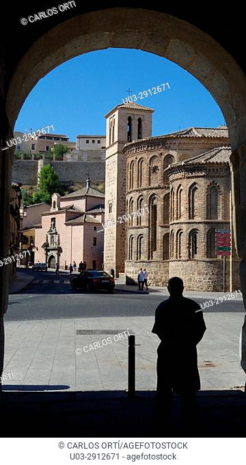 Tourist near the Church of Santiago del Arrabal, a small temple in the outskirts of the spanish town of Toledo, Spain, Europe