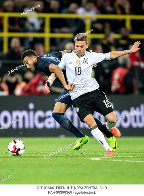 Germany's Joshua Kimmich (R) in action against England's Ryan Bertrand during the international friendly soccer match between Germany and England at Signal...