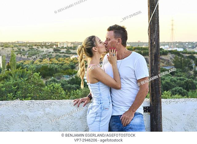 romantic couple kissing during sunset. Australian ethnicity. During holiday stay in Hersonissos, Crete, Greece