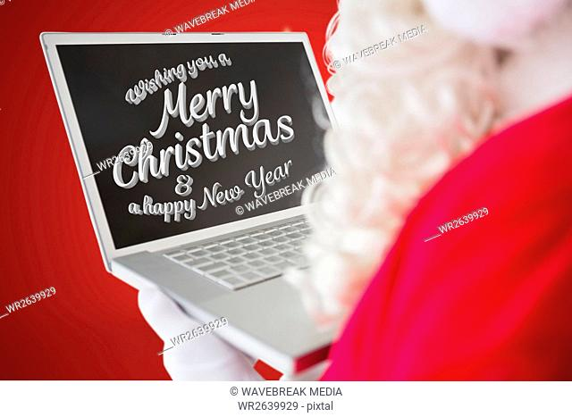 Santa claus using laptop against red background