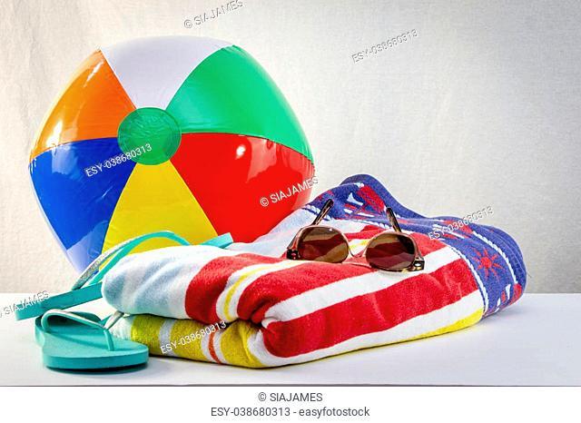 beach towels with flip-flop, sunglass and beach balloon