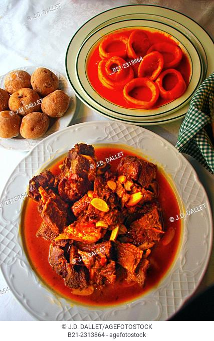'Papas arrugadas' (potatoes cooked in sea water), goat meat in sauce and squids, Tenerife, Canary Islands, Spain