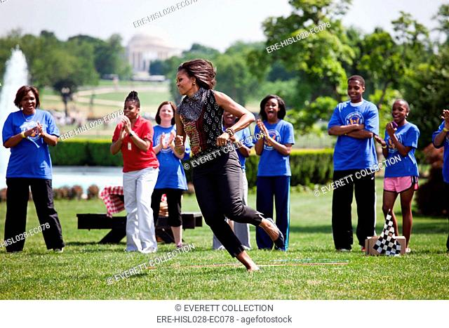 First Lady Michelle Obama participates in the Pit Crew Challenge during an event with the President's Council on Fitness Sports and Nutrition on the South Lawn...
