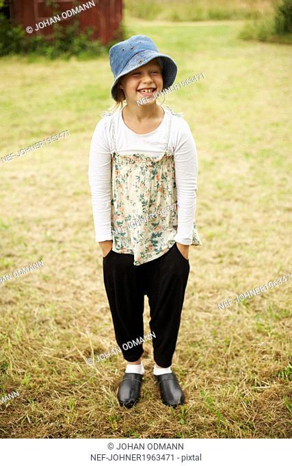 Smiling girl wearing sun hat