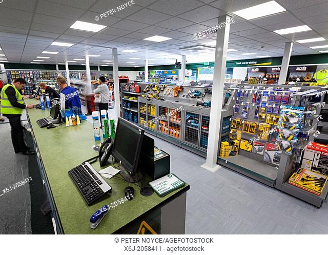 customers at sales counter in Travis Perkins Builders Merchants shop