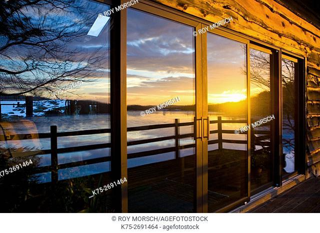 Winter lake reflection on windows