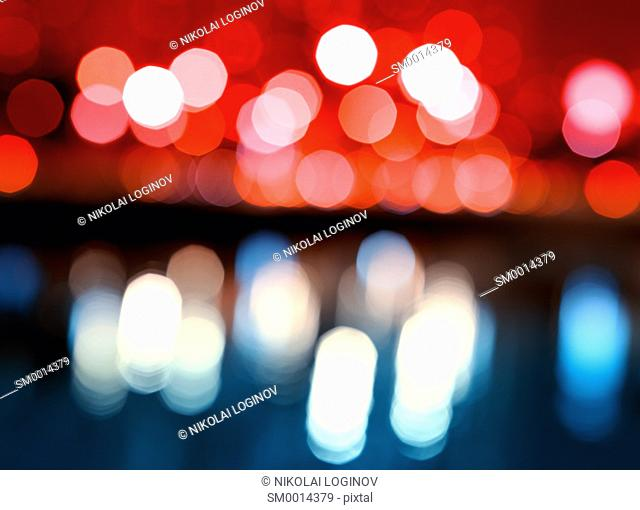 Night city lights bokeh with reflections background hd