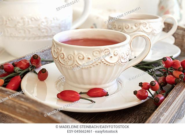 Rose hip tea in a white vintage cup