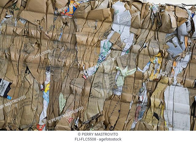 Bale of recyclable cardboard at a sorting centre, Quebec, Canada