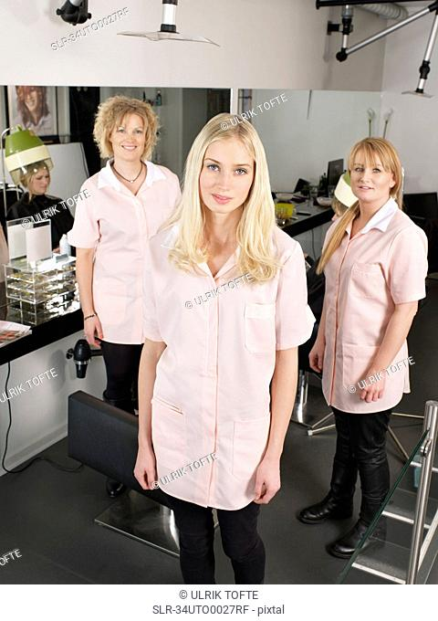 Hairdressers standing in salon