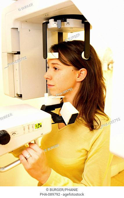 Young woman undergoing panoramic dental X-ray