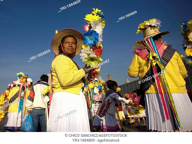 An indigenous Mazahua woman from San Pedro el Alto, San Felipe del Progreso, Estado de Mexico carries a crown of flowers as part of the Danza de las Carmelitas