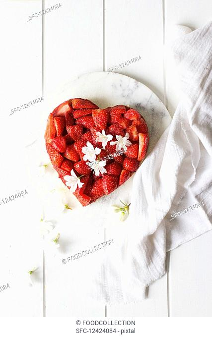 A heart-shaped cake with strawberries