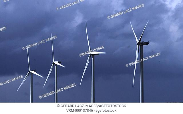 Wind Turbines with Cloudy Sky, near Caen in Normandy, Slow Motion