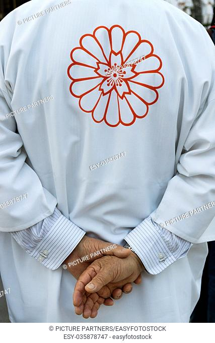 Hiroshima, Japan - May 27, 2017: Participant dressed in traditional kimono with a flower on the back at a festival