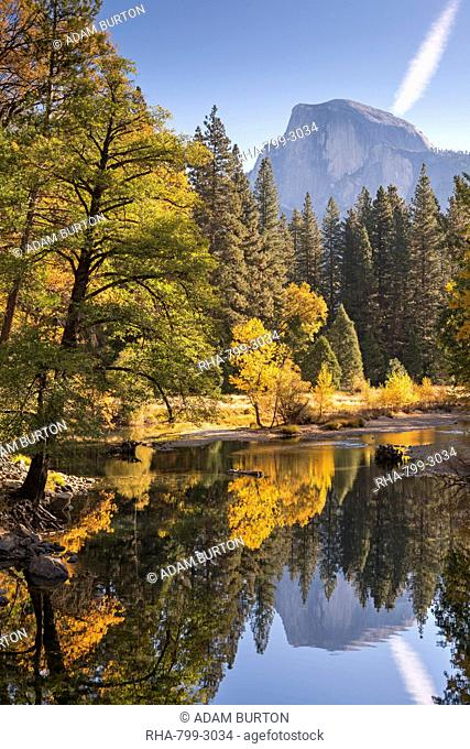 Half Dome and the Merced River surrounded by fall foliage, Yosemite National Park, UNESCO World Heritage Site, California, United States of America