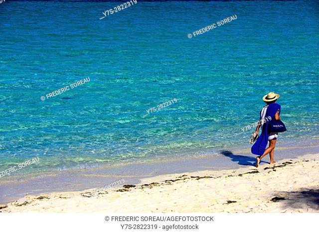 Woman walking on a beach of Cayo Santa Maria, Cuba