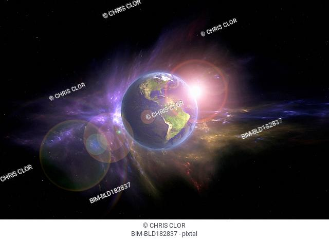 Earth and galaxy in outer space