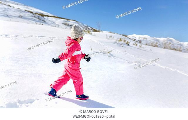 Little girl walking in snow