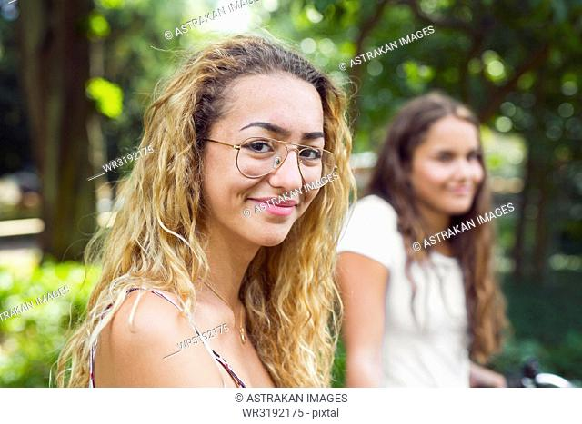 Two teenage girls (14-15) in park