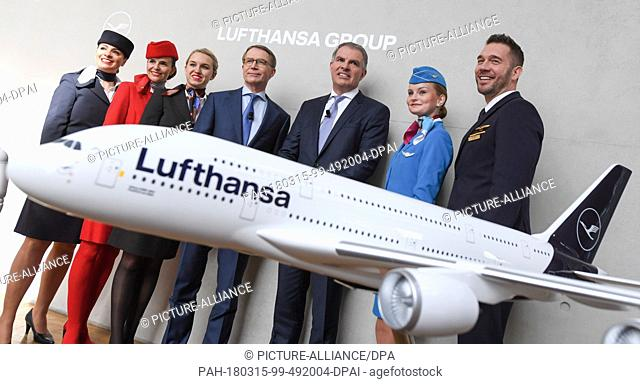 15 March 2018, Germany, Frankfurt am Main: Carsten Spohr (3rd from right), CEO of Deutsche Lufthansa AG, and CFO Ulrik Svensson (C) standing with stewardesses...