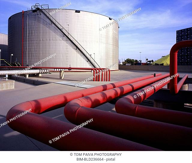 Red pipes near storage tank