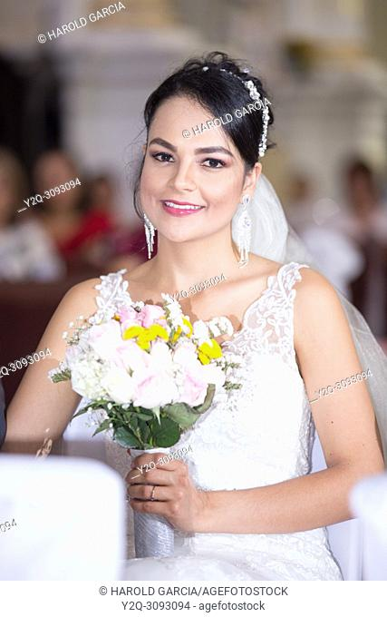 Bride smiling in a wedding ceremony