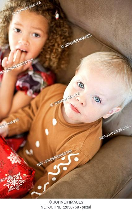 Girl and baby boy with Christmas present