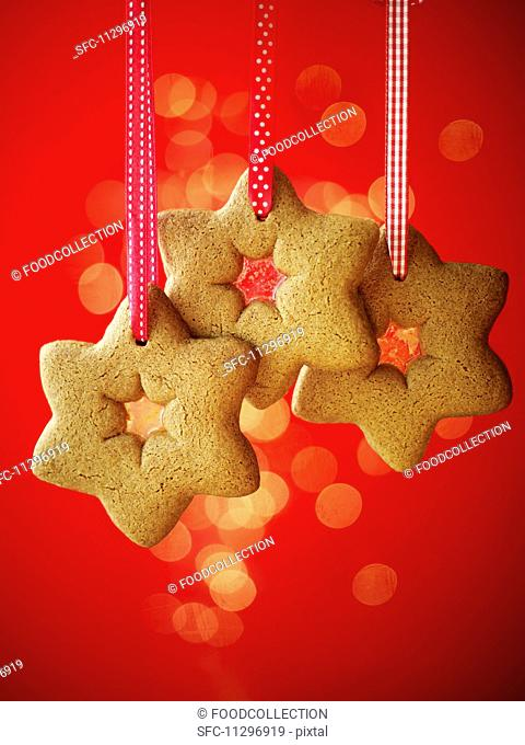 Gingerbread stars hanging from ribbons