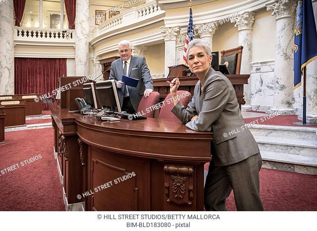 Caucasian politicians standing in capitol building