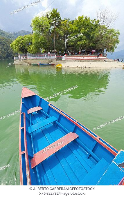Wooden Rowing Boatst browsing to small Island Tal Barahi Temple, Phewa Lake, Fewa Lake, Pokhara, Nepal, Asia