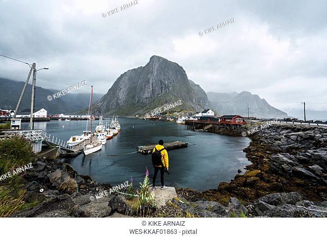 Norway, Lofoten, rear view of man standing at the coast