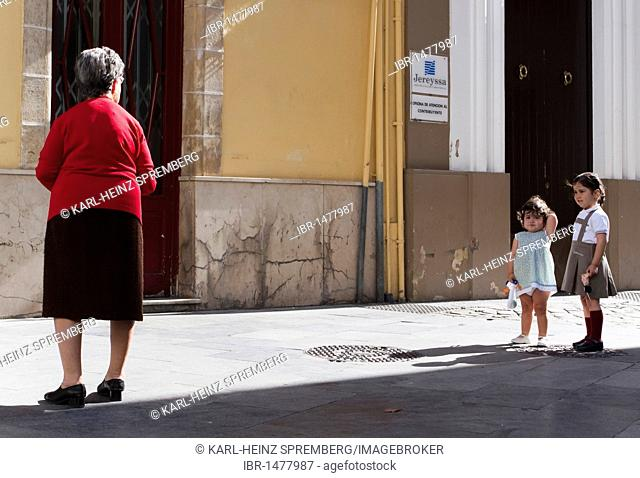 Two little girls are in conflict with their grandmother, Spain, Europe